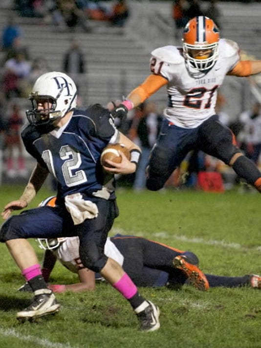 Andrew Henry, left, escapes from pressure during Dallastown's 28-0 win over William Penn last season.