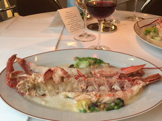 Lobster is accompanied by extravagantly fresh vegetables at Arpège restaurant in Paris.