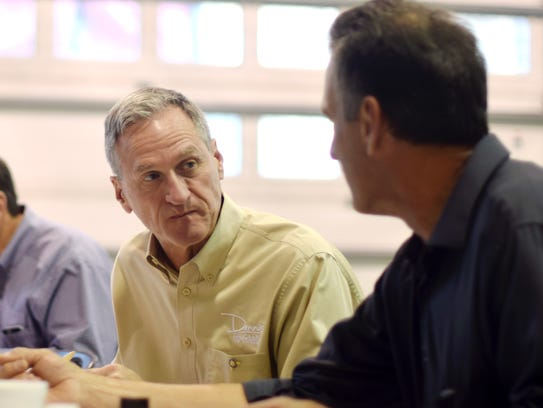 South Dakota Gov. Dennis Daugaard, left, talks with