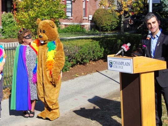 Burlington Mayor Miro Weinberger speaks at the opening of the rainbow crosswalk painting event at Champlain College on Wednesday. At left is the college's mascot Chauncey T. Beaver, Superhero Prism (Carol Moran Brown) and Sandra Yusen, director of communications and external affairs.