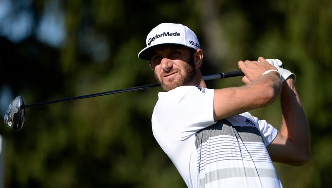 Dustin Johnson tees off from the 12th hole during the first round of the RBC Canadian Open at Royal Montreal GC - Blue Course on July 24.