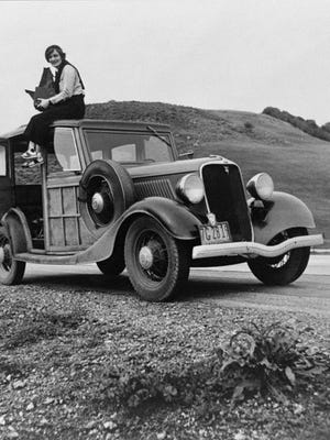 This 1936 image provided by the Library of Congress shows Resettlement Administration photographer Dorothea Lange sitting atop a vehicle in California. Lange is among the women whose stories are featured as part of The Women on the Mother Road project, a partnership between Cinefemme and the National Park Service to highlight women's experiences along historic Route 66.