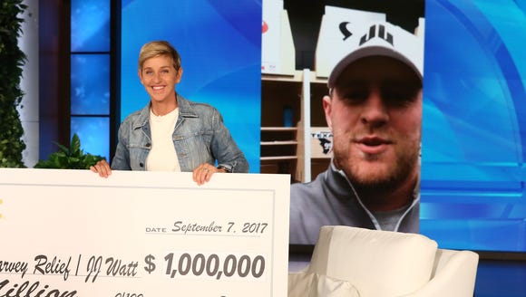 Ellen DeGeneres presents a check for $1 million to