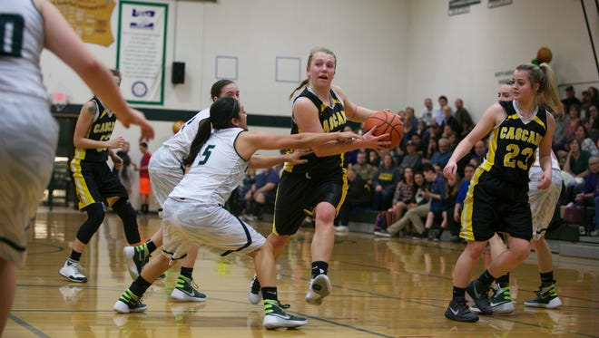 Cascade sophomore Kelsey Molan (5) looks to pass to a teammate at the Oregon West Conference championship at North Marion High School on Tuesday. Her best chance to make the entry pass was a bounce pass.