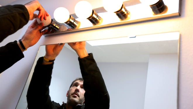 An A-TEC Energy employee performs a home energy audit for MidAmerican Energy in 2014.