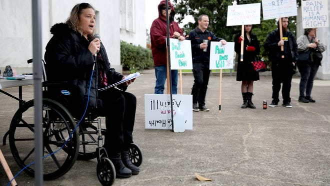 Eve Blackburn, 55, of Corvallis, speaks during a protest of restrictive laws on opioids that patients say hurt the people who rely the drugs to live with less pain at the Oregon State Capitol in Salem on Saturday, April 7, 2018.