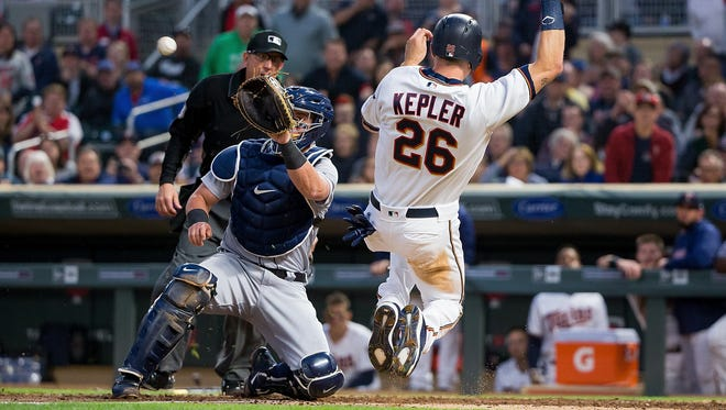 May 21, 2018; Minneapolis, MN, USA; Minnesota Twins outfielder Max Kepler attempts to slide before Detroit Tigers catcher James McCann can apply the tag in the fifth inning at Target Field. Kepler was called out.