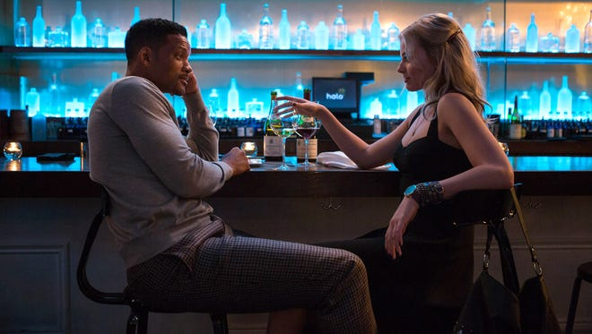 Will Smith, left, as Nicky and Margot Robbie, as Jess in a scene from 'Focus.' (Frank Masi, Warner Bros. Pictures)