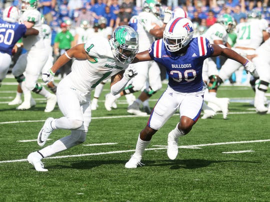 Louisiana Tech defensive back Darryl Lewis (38) attempts to block North Texas wide receiver Turner Smiley (1) during a game at Joe Aillet Stadium in Ruston, La., Saturday, Nov. 4, 2017.