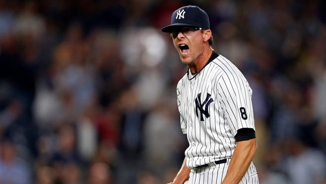 Yankees relief pitcher Tyler Clippard (29) reacts after the final out against the Red Sox.