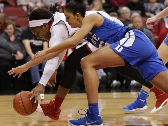 Myisha Hines-Allen fights for a loose ball against