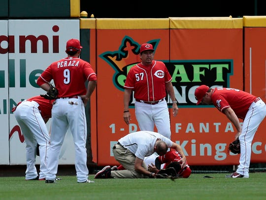 Cincinnati Reds center fielder Billy Hamilton (6) remains down as he's examined by trainers in left-center field after being hit in the face with a ball off the bat of Chicago Cubs first baseman Anthony Rizzo (44) that became an inside-the-park home run in the top of the first inning of the MLB National League game between the Cincinnati Reds and the Chicago Cubs at Great American Ball Park on Wednesday, June 29, 2016. After one inning, the Cubs led 3-0.