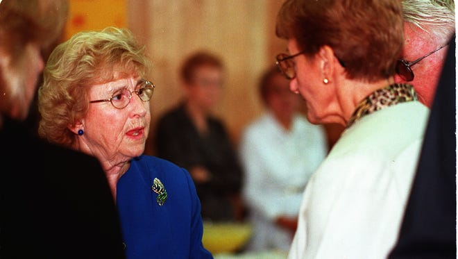 Marge Spezzano, left, wife of the late publisher Vince Spezzano, talks to friends at a reception following his  funeral in Florida in 1999.