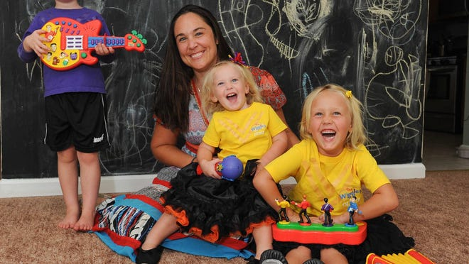 Megan Nehrbas and her children John Roman Nehrbas, left (4), Fiona Nehrbas and Olivia Nehrbas (5) are big fans of the Wiggles.