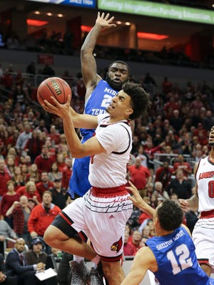 U of L's Jordan Nwora (33) worked against MTSU during the NIT at the Yum Center in Louisville.    Mar. 18, 2018
