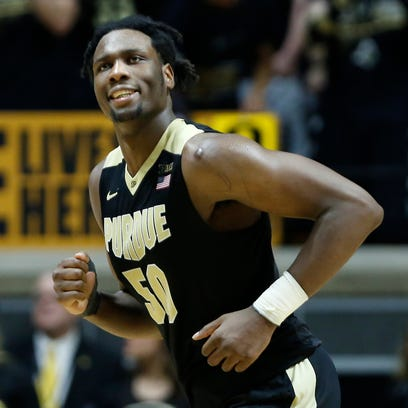 Caleb Swanigan smiles as he head to the bench during