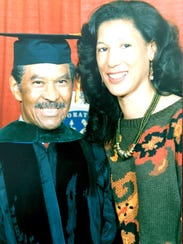 Dr. Luther Lemon, shown with his daughter Jan-Michele Lemon Kearney, is awarded the degree of Fellow of the American Academy of Family Physicians in 1989, four years before his retirement.
