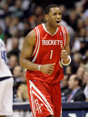 Houston Rockets guard Tracy McGrady celebrates after making a basket during the third quarter of a basketball game against the Dallas Mavericks, Thursday, March 6, 2008, in Dallas.