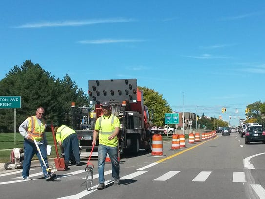 Workers prepare a section of Main Street in Pleasant