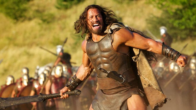 The Rock, shown here in 'Hercules' opening July 25, has words about screen rival 'The Legend of Hercules.'