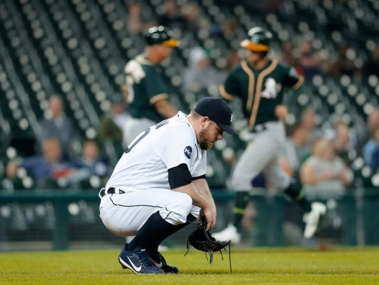 Tigers pitcher Alex Wilson reacts to allowing a Athletics