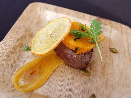 Caramelized beef tenderloin with orange soy condiment and butternut squash from J&G Steakhouse at the 2017 azcentral.com Food & Wine Experience.