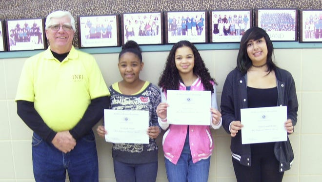 Pictured from left to right: Kiwanis Club member Ned Kline, Ne'veyah Enjady, Lauren Love and Juliana Lueras-Rocha.