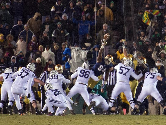 BYU Cougars kicker Justin Sorensen attempts a field