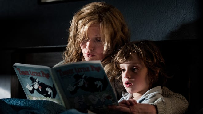 """Essie Davis stars as a single mom who reads a book to her son (Noah Wiseman) and unknowingly unleashes a monster in """"The Babadook."""""""