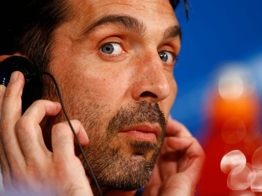 Juventus goalkeeper Gianluigi Buffon attends a news conference prior the Champions League round of 16 second leg soccer match between Bayern Munich and Juventus Turin in Munich, Germany, Tuesday, March 15, 2016. Bayern will face Juventus on Wednesday. (AP Photo/Matthias Schrader)