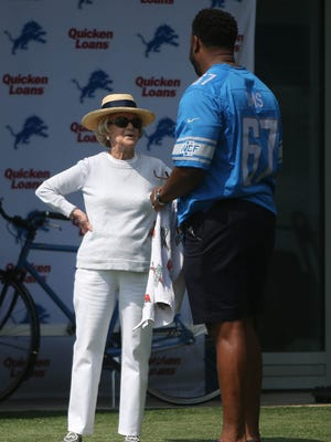 Lions owner Martha Ford talks with former Lions offensive lineman Rob Sims, August 1, 2017 in Allen Park.