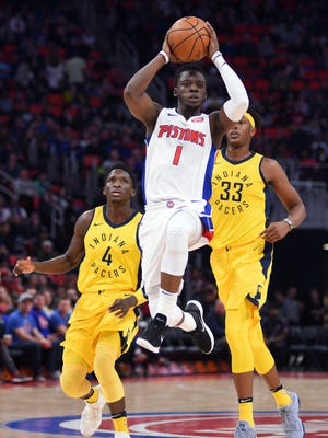 Reggie Jackson passes the ball against the Pacers on Dec. 26 at Little Caesars Arena.