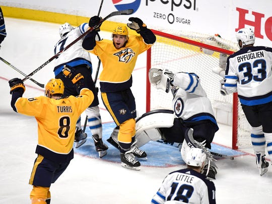 Predators left wing Kevin Fiala (22) celebrates his goal with Predators center Kyle Turris (8) who assisted on the goal during the third period in game 1 of the second round NHL Stanley Cup Playoffs at the Bridgestone Arena Friday, April 27, 2018, in Nashville, Tenn.