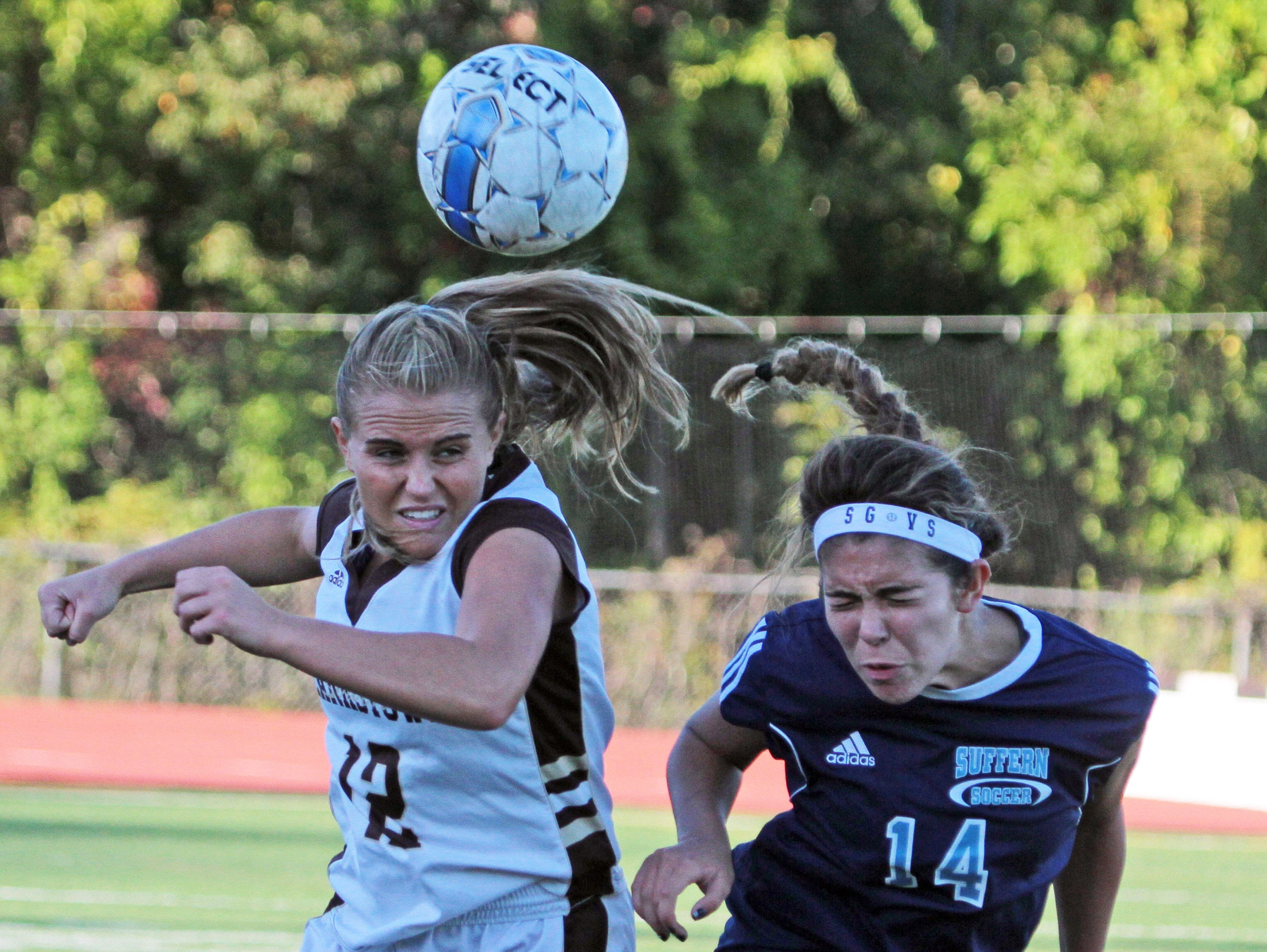 Clarkstown South's Danielle Gillespie and Suffern's Tatiana Cruz battle for the ball during a varsity soccer game at Clarkstown South High School Oct. 6, 2015. Clarkstown South handed Suffern it's first loss of the season with a 4-1 victory.