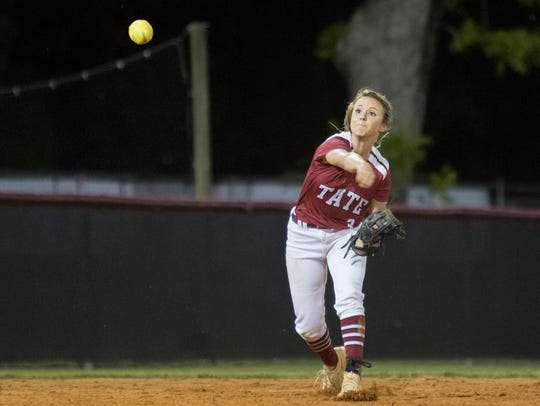 Shortstop Shelby McLean (3) throws to first for an