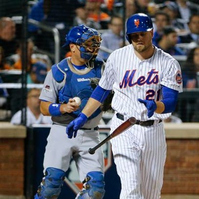 The Mets' Lucas Duda flips his bat after striking out