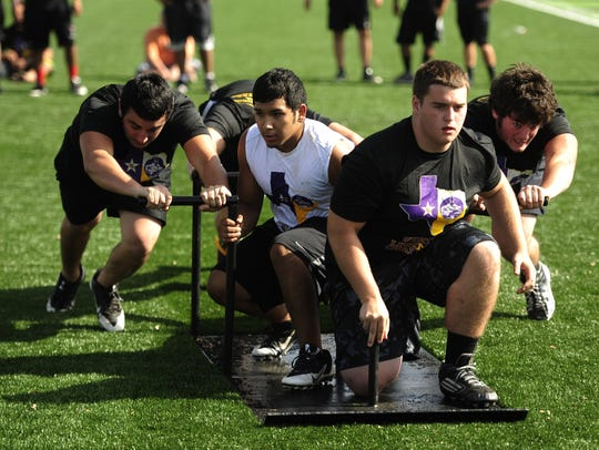 Cisco football players compete in the truck push event