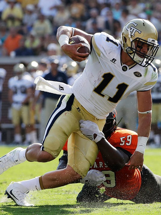 FILE - In this Sept. 10, 2016, file photo, Georgia Tech quarterback Matthew Jordan (11) runs the ball as Mercer's Tunde Ayinla tries to make the tackle in the second half of an NCAA college football game in Atlanta. Georgia Tech coach Paul Johnson is faced with a decision he has not had to make in recent years: choosing a starting quarterback.(AP Photo/David Goldman, File)