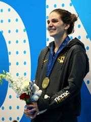 Lexington grad Hannah Stevens in the afterglow of winning the 50 meter backstroke at the U.S. Nationals in Indianapolis.