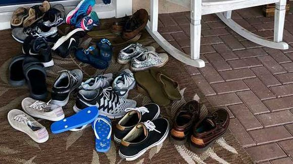 A porch full of shoes means a house full of kids. Florida