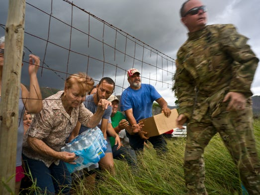 A member of the Puerto Rican National Guard delivers