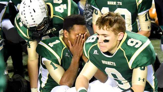 Wilson Memorial's Juh-Kwquan McCauley and Garret McBee feel the emotions of their loss to Glenvar High School who won in overtime during the VHSL Group 2A high school football state championship game at Salem City Stadium on Saturday, Dec. 13, 2014.