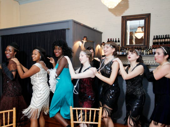 Asheville School students make a conga line during