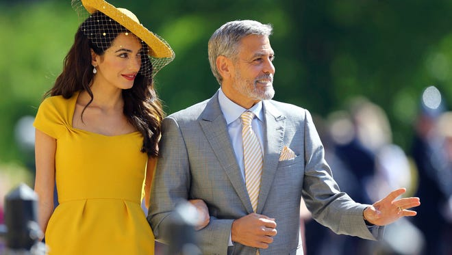 Amal and George Clooney arrive for the wedding ceremony of Prince Harry and Meghan Markle at St. George's Chapel in Windsor Castle in Windsor, near London, England, Saturday, May 19, 2018. (Gareth Fuller/pool photo via AP)