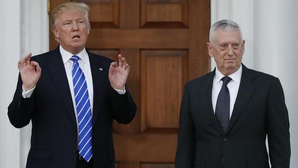 President-elect Donald Trump calls out to media as he stands with retired Marine Corps Gen. James Mattis at Trump National Golf Club Bedminster clubhouse in Bedminster, N.J., Saturday, Nov. 19, 2016.