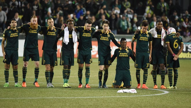 Portland Timbers players wait during the shootout in an MLS playoff soccer match against Sporting Kansas Ciry in Portland, Ore., on Thursday, Oct. 29, 2015. The Timbers won 7-6 in the shootout after a 2-2 draw.
