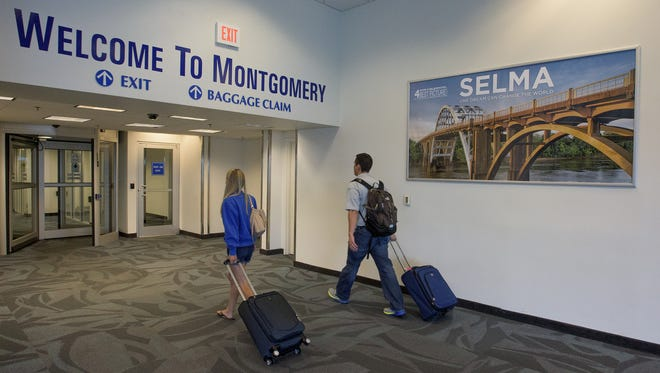 Passengers arrive at the Montgomery Regional Airport in Montgomery, Ala. on Wednesday August 12, 2015.