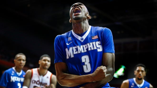 University of Memphis guard Jeremiah Martin celebrates a made basket during second half action against the University of Cincinnati defense at Fifth Third Arena in Cincinnati, Ohio.