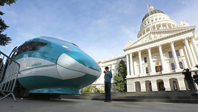 In this Feb. 26, 2015, file photo, a full-scale mock-up of a high-speed train is displayed at the Capitol in Sacramento/