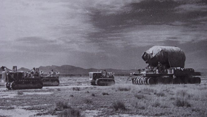 """In this historic photo, military personnel are seen moving """"Jumbo"""" to Trinity Site. One of the concerns of the scientists who built the """"Gadget"""" nuclear device that was detonated at Trinity Site in 1945, was that the bomb might not actually go off."""